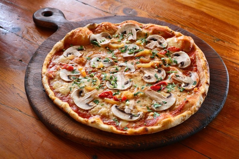 Appetizing Pizza With Mushrooms On A Wooden Tray Stock