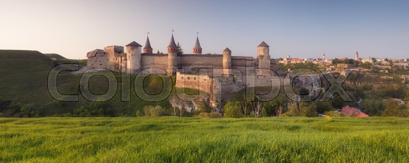 Landscape panorama of the old fortress on the hill. Evening in the old town. Kamenetz-Podolsk, Ukraine, Europe, stock photo