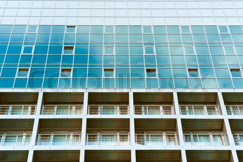 Blue glass building with balconies, stock photo