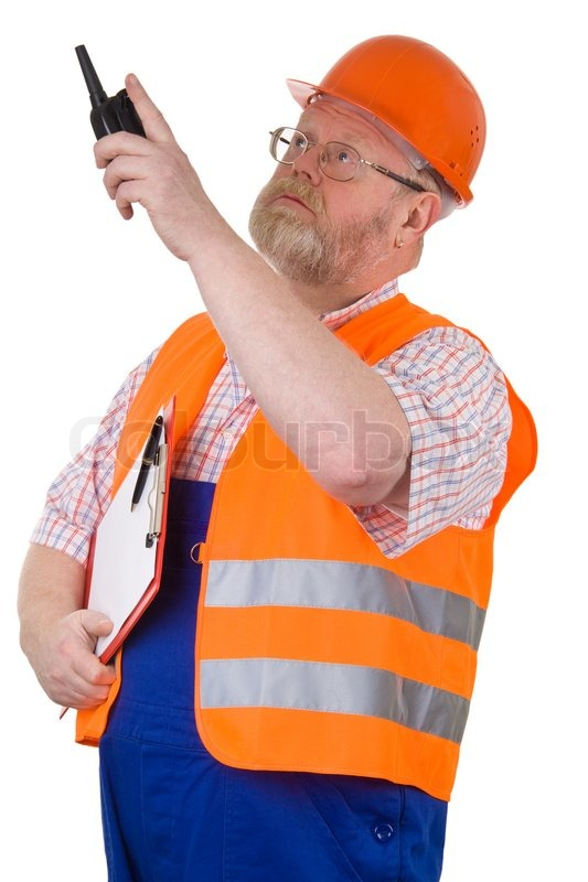 Construction Supervisor With Walkie Talkie Pointing On A Building Isolated Stock Photo