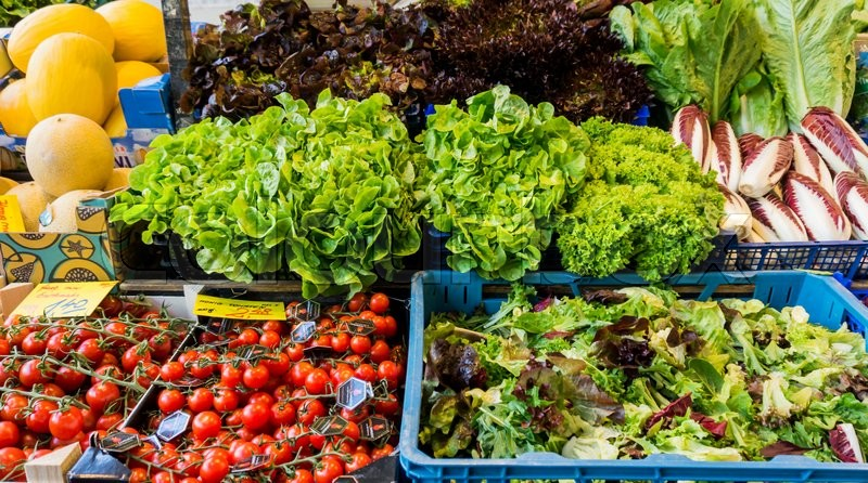 Market with various colorful fresh fruits and vegetables. Farmers market. Fresh vegetables on shelf in supermarket, stock photo