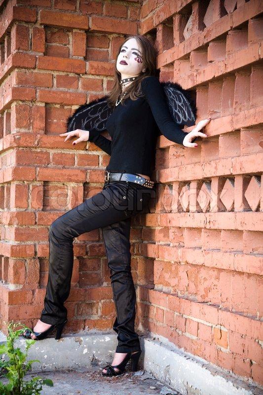 Gothic Angel Against Brick Wall