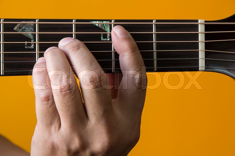 Hand Performing B Chord On Guitar Stock Photo Colourbox