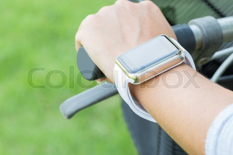 Closeup hand wear smart watch riding bicycle exercise sport, stock photo