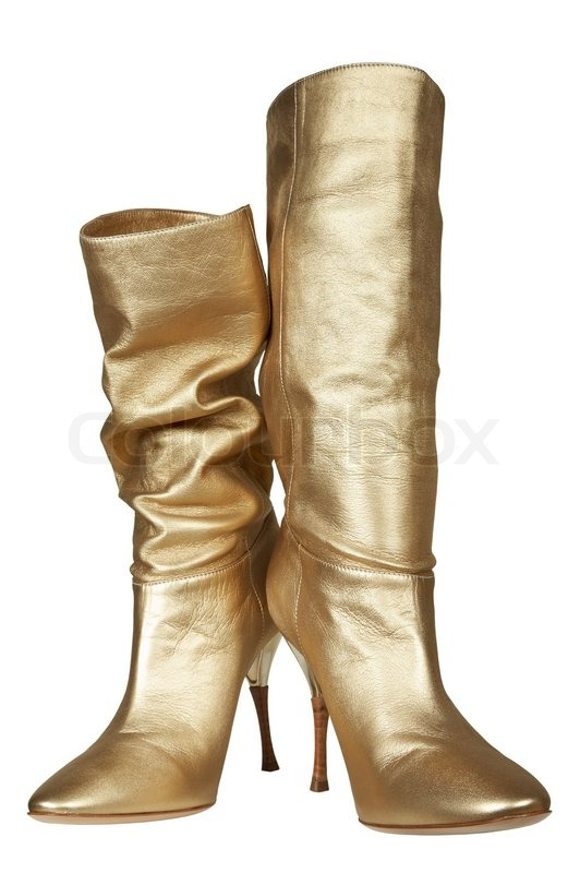 Female boots of gold color on a high heel | Stock Photo | Colourbox