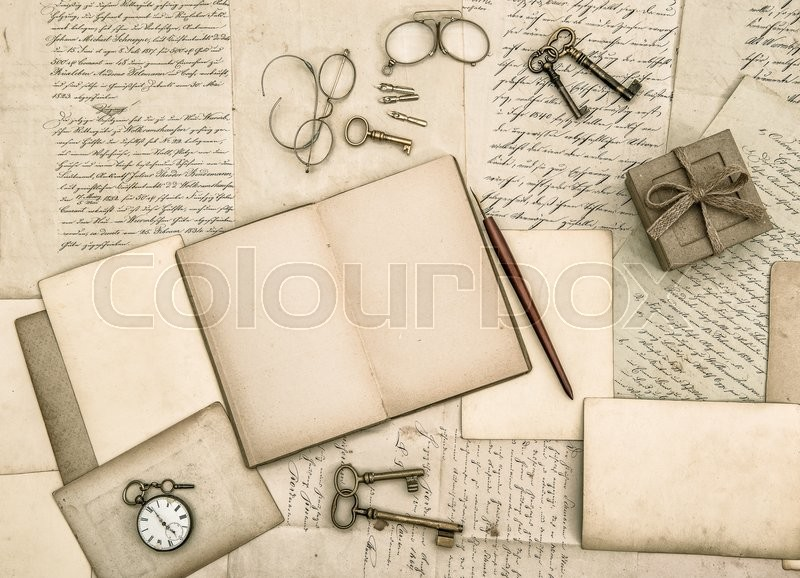Vintage handwriting and antique office tools. Nostalgic paper background, stock photo