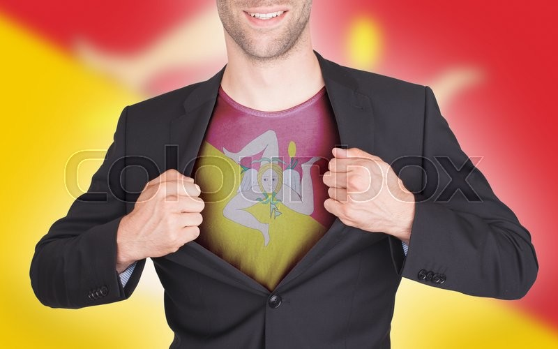 Businessman opening suit to reveal shirt with flag, Sicily, stock photo
