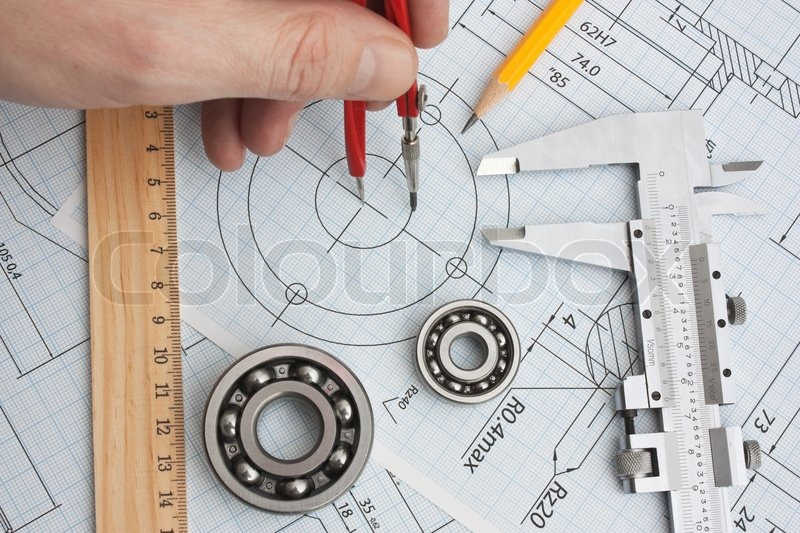 Technical drawing and tools in hand, stock photo