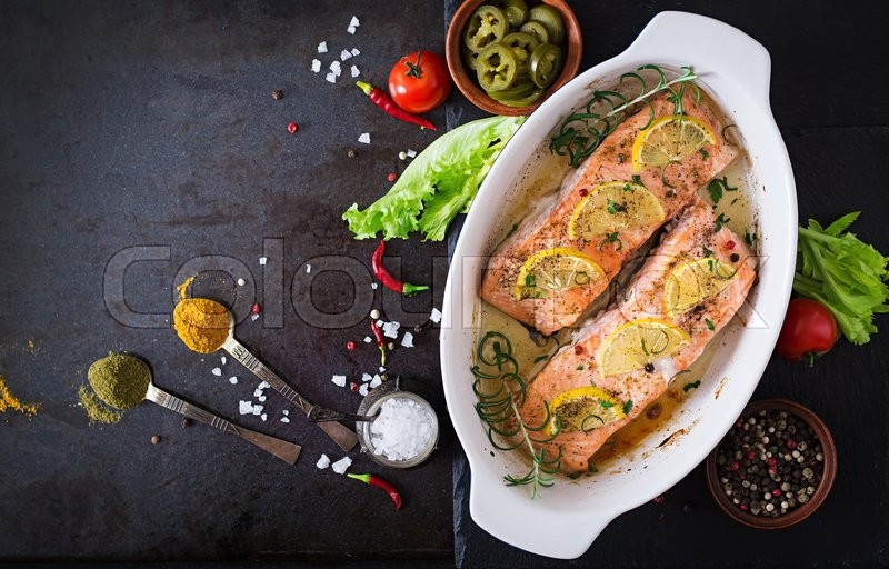 Baked salmon fillet with rosemary, lemon and honey. Top view, stock photo