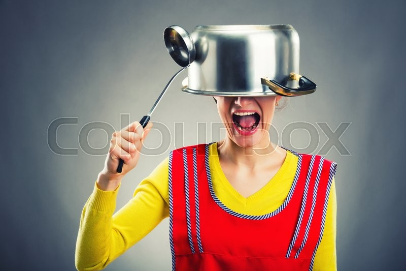 Crazy housewife with sause pan on her head, stock photo