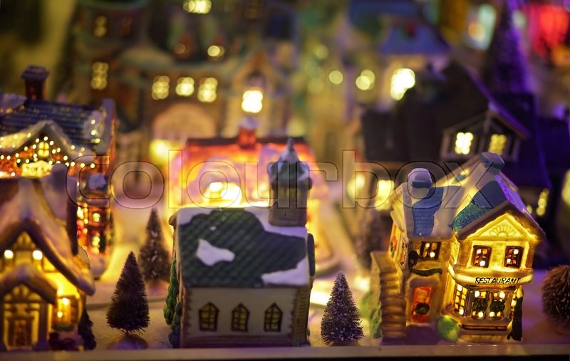 lalor park australia december 24 2014 miniature european christmas village scene with twinkling lights at night window display stock photo