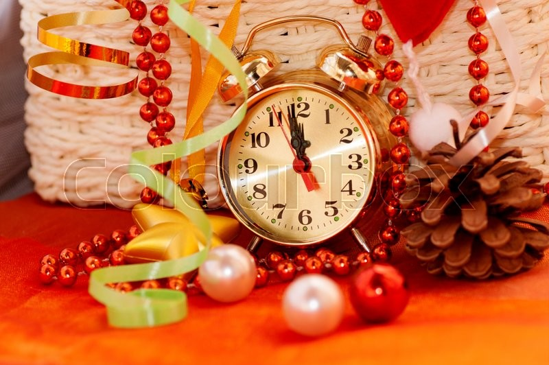 Basket with Christmas toys and clock hands for 12 hours, stock photo