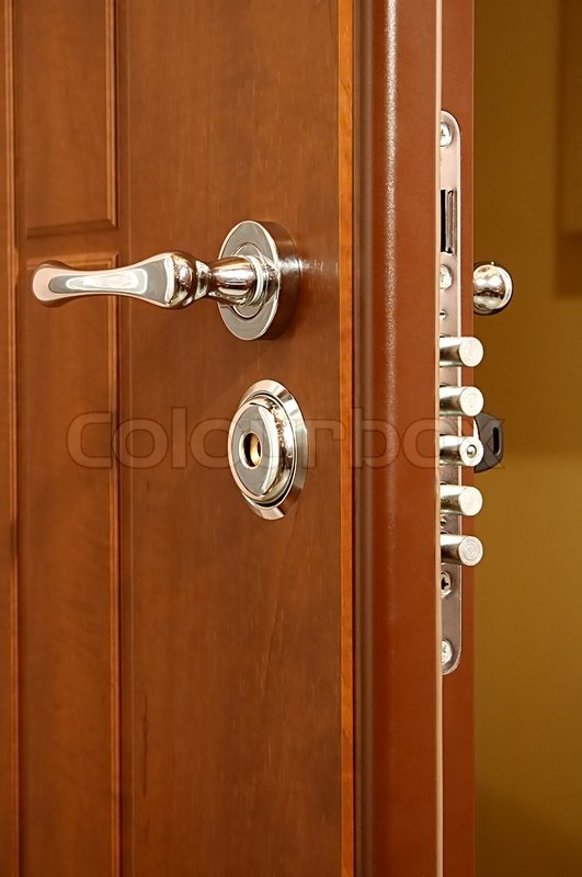 The Modern And Safe Lock On A Wooden Door Stock Photo