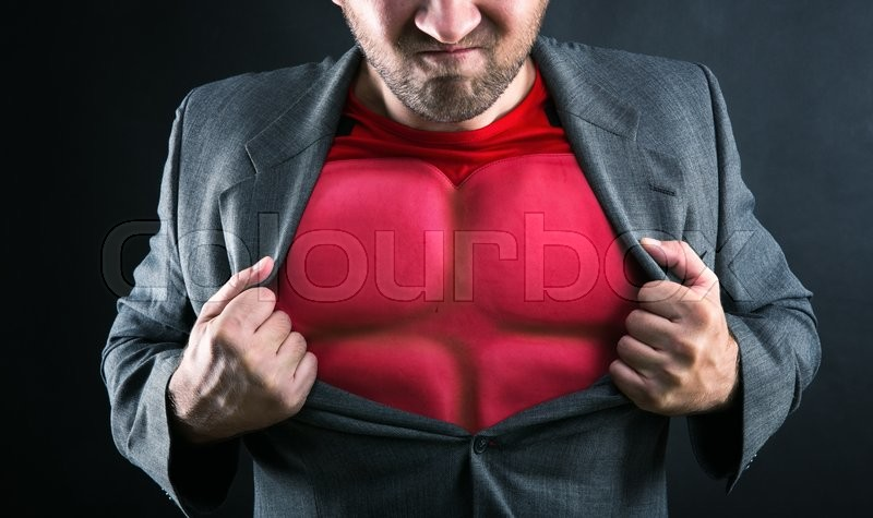 Stock image of 'Man showing his flack jacket through his suit on grey background'