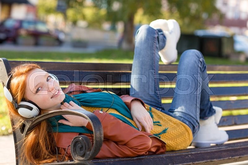 Redhead on bench