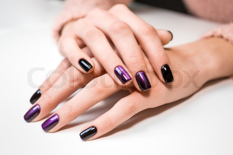 Hand on hand with nice manicure. Shellac complete Manicure process in salon nail salon, stock photo