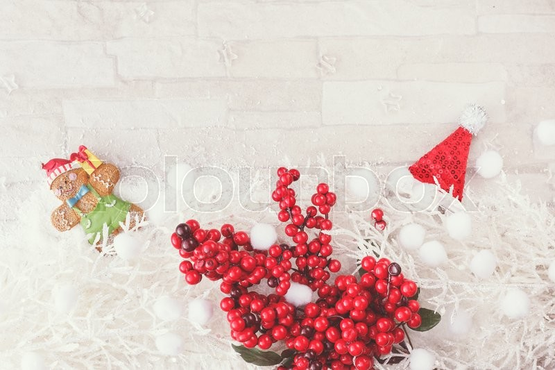 Christmas and New Year decoration background. Red and white Christmas arrangement with white fir branches, gingerbread and Christmas decoration. Top view, vintage color filter, blank space, stock photo