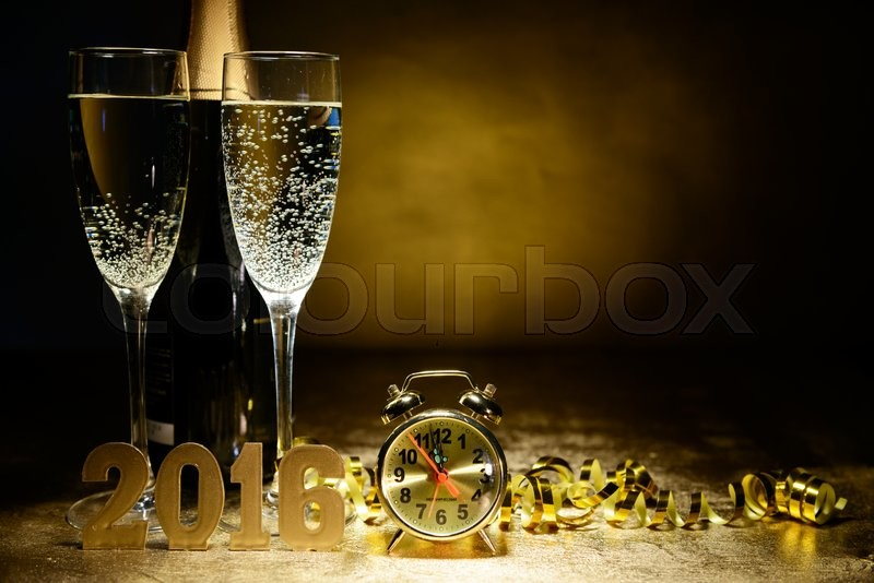 Two glasses of champagne on a gold background. Christmas and New Year theme, stock photo
