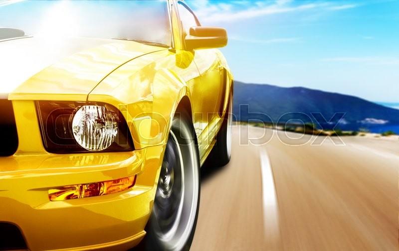 Yellow sport car on a narrow road, stock photo