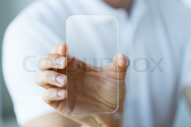 Business, technology and people concept - close up of male hand holding and showing transparent smartphone at office, stock photo