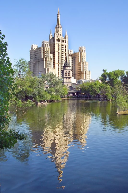 High building reflects under the zoo lake, stock photo