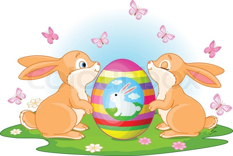Two Cute Rabbits Holds Easter Egg On The Spring Meadow