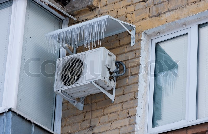 Air Conditioning Heat Pump Mounted On Brick Wall Stock