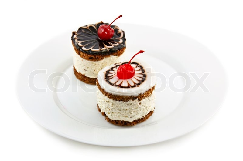 Two cakes on the plate shallow depth of field stock photo