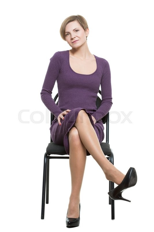Woman Sits A Chair Pose Showing Sexual Stock Photo