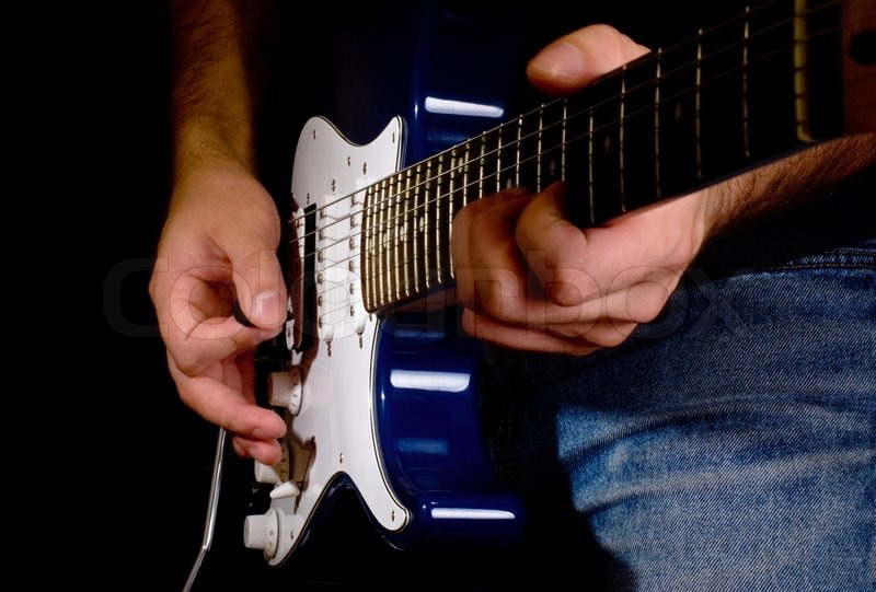 Man Playing On Electric Guitar In The Stock Photo Colourbox