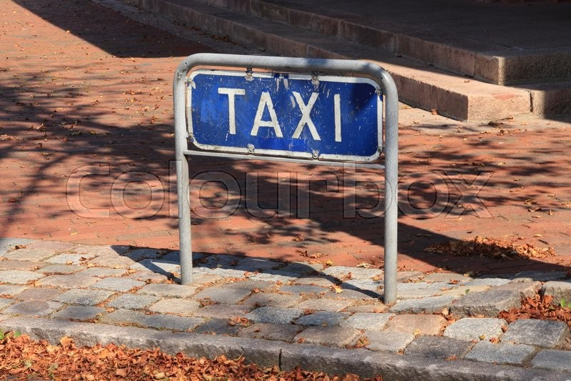 Attention, parking space for taxi nearby the train station in the oldest town of Denmark, Ribe, in the beautiful summer, stock photo