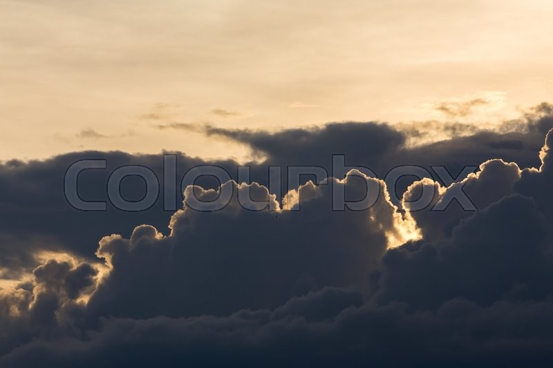 Beautiful sunset sky, dramatic moody sky, black cloudy on yellow light sky background, stock photo