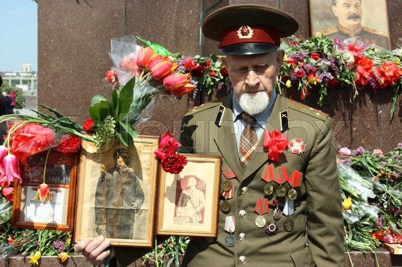 Zaporozhye, Ukraine 2011 .Parad victory on May 9 veteran with medals near the monument to Lenin, stock photo