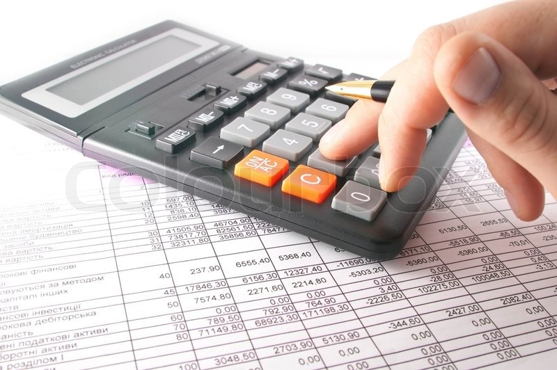 Close up of a calculator, spreadsheet, data and pen on a table ...