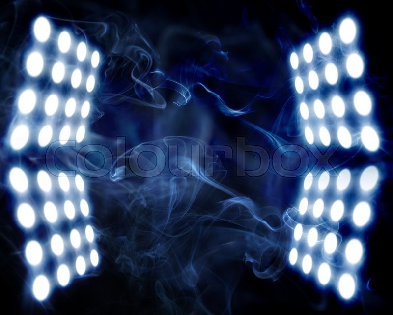 Stage spot lights in artificial abstract smoke, stock photo