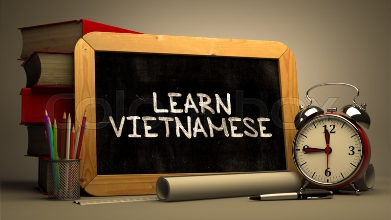 Learn Vietnamese - Chalkboard with Hand Drawn Motivational Quote, Stack of Books, Alarm Clock and Rolls of Paper on Blurred Background. Toned Image, stock photo