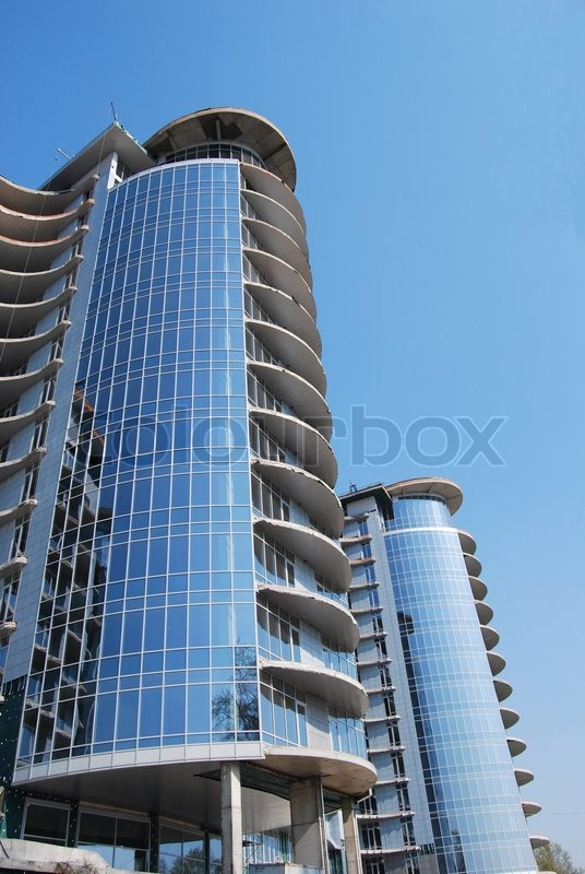 Final stage of modern building construction stock photo for Building construction types for insurance