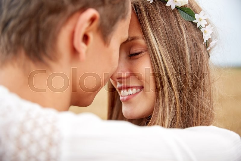 Summer holidays, love, romance and people concept - happy smiling young hippie couple hugging outdoors, stock photo