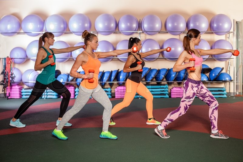 Small group of women doing a leg exercise in aerobics class, stock photo