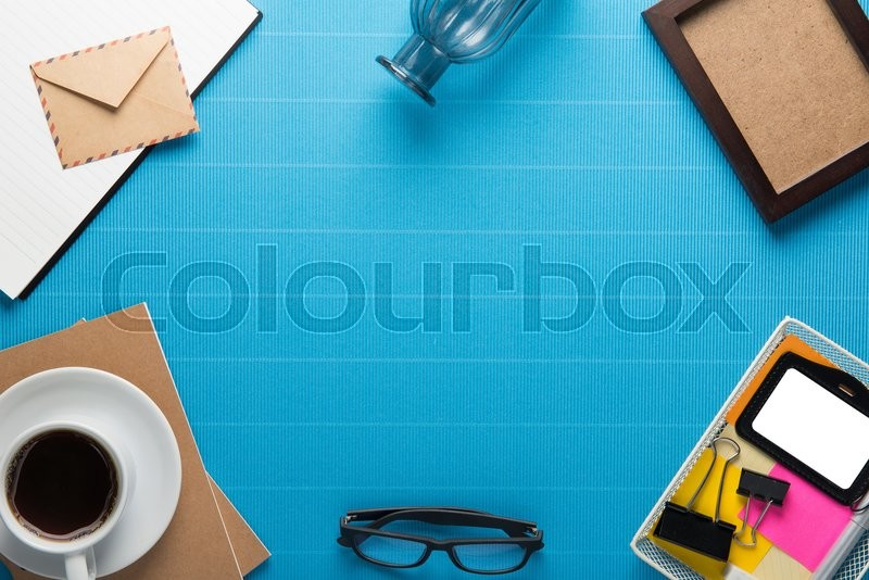 Office workplace,office Equipment and coffee break on blue crepe paper desk, stock photo