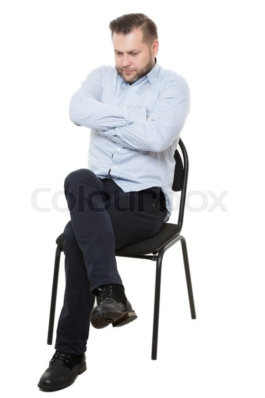 Man sitting on chair  Isolated white     | Stock image | Colourbox