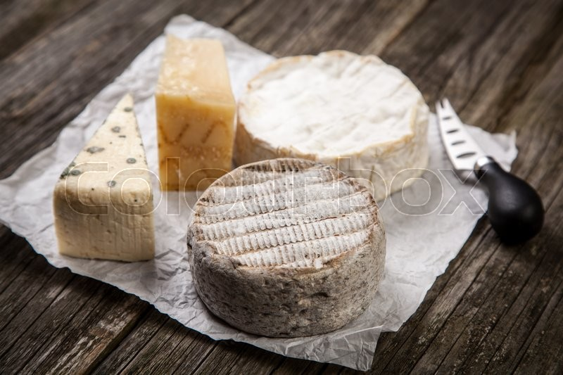 Soft french cheese of camembert and other types, stock photo