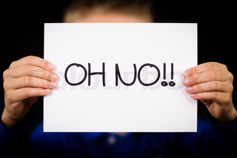 Studio shot of child holding an Oh No sign made of white paper with handwriting, stock photo