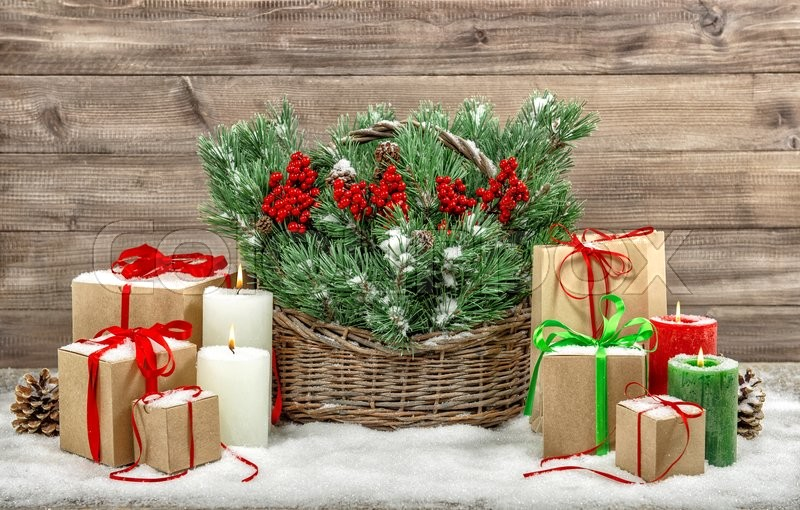 Christmas decoration with burning candles and gift boxes. Vintage style still life, stock photo