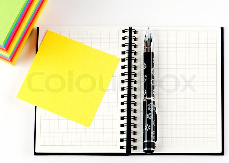 Pencil on open note book. Colorful paper notes, stock photo