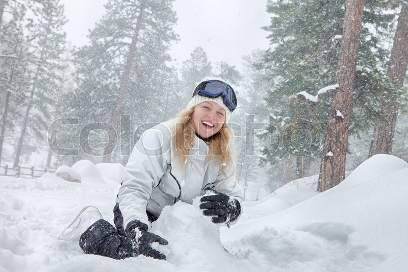 Portrait of young beautiful woman on winter outdoor background, stock photo