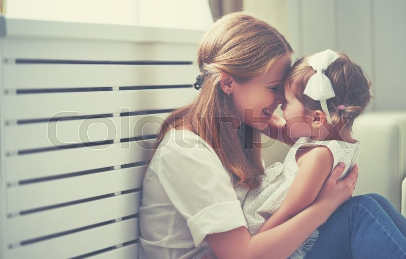 Happy loving family. mother and child girl playing, kissing and hugging, stock photo