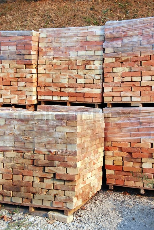 Stacks of packed bricks outdoor building material stock for Materials needed to build a house