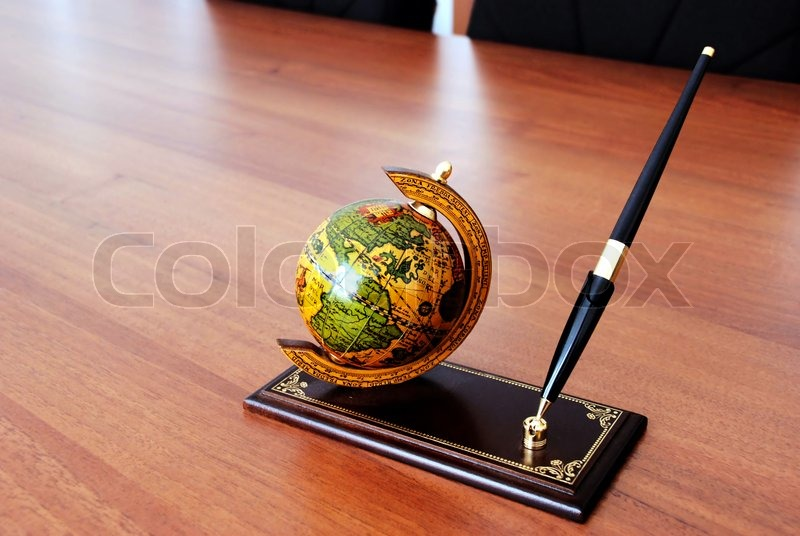 Superior Globe And Pen On Prop Over Brown Office Desk, Stock Photo