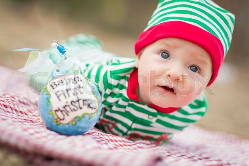 Beautiful Infant Baby On Blanket With Babys First Christmas Ornament, stock photo